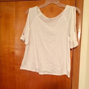 Flowy tee with cut out cold shoulder-like arms.